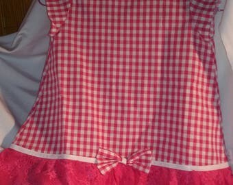 Girl in gingham and lace fabrics dress