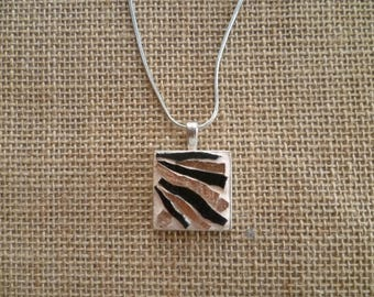 Bright pink and black mosaic square pendant.