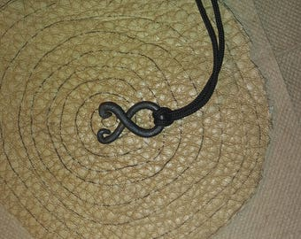 Small troll cross pendant