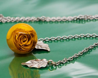 Hand-made pendant with genuine dried rose on a necklace, unique