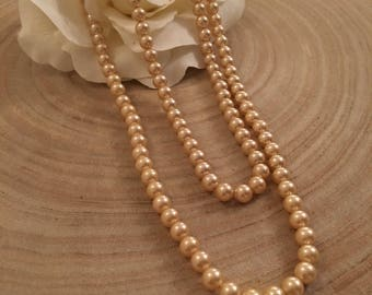 Two strand faux pearl necklace with fish hook fastening