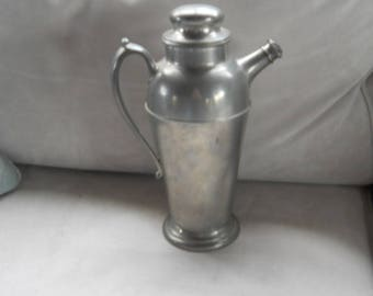Antique pewter pitcher with lid