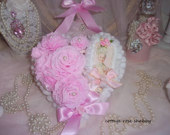 Heart shabby chic rose tassels, and her Marie Antoinette medallion, stamped with romance...