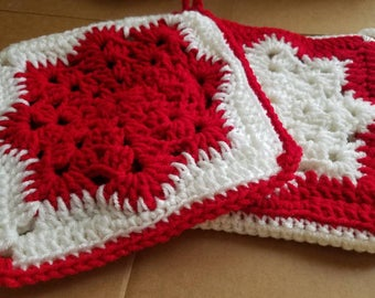Holiday crochet red and white snowflake potholders or trivets