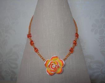 Orange flower pendant necklace