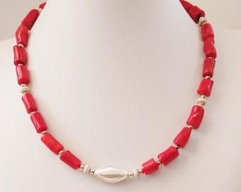 Coral tube shaped beads necklace with single oval stardust Sterling Silver and small Sterling Silver beads.
