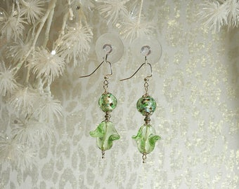 Ruffled Glass Spirals Float Under Glass Covered Foil Beads.  Silver Finish French Hooks and Findings. Nickle Free. Approx. 2.5 long.