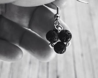 Earrings with lava stones.