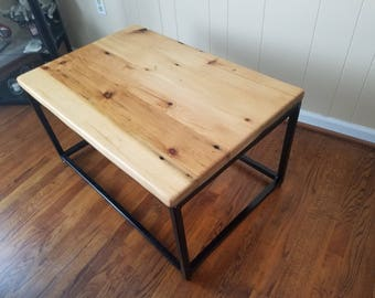 Coffee table made of reclaimed pine barnwood with metal base