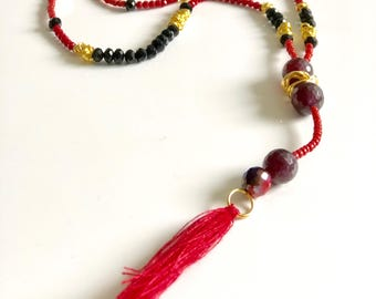 Red necklace with tassel and clasp