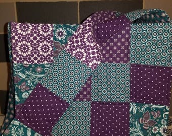 Quilted over the shoulder tote bag