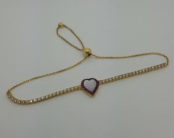 sterling silver, yellow gold plated, white and red CZ with heart shaped mother of pearl