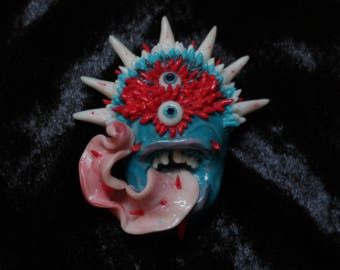 Monster brooch
