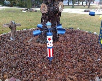 Patriotic solar LED spinning yard art