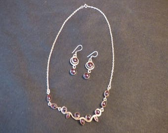 Silver and garnet necklace and earring set