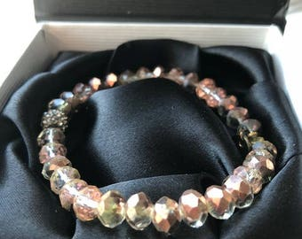 Peach colored, multi-faceted, crystal bracelet.