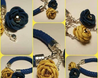 Blue leather bracelet with various colours of leather flowers