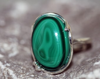 Malachite Ring. Intriguing piece of Malachite fitted in sterling silver. Handmade & unique. Ring is adjustable.