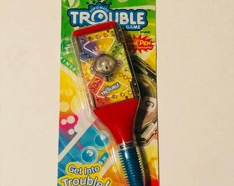Hasboro game, trouble pen get into trouble game pen