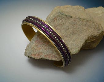 Mosaic Brass Cuff Bracelet with purple Hematite inlaid beads and sterling silver inlay in black polymer clay.