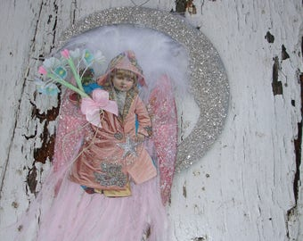 Angel girl on the moon ornament*  Megan McKenzie*She collects stars for a living
