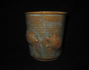 Vase or utensil holder with turtles in tans and greens, stoneware pottery