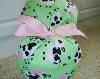Fold Up Ponytail Surgical Scrub Hat with Cows on Light Green
