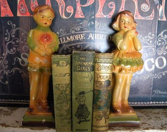 Vintage Pair of 1920's Chalkware Figures Boy and Girl Child Holding Flowers Bookends