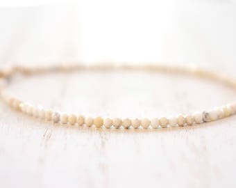 faceted howlite bracelet. yellow gold filled. delicate white faceted howlite . winter 'whites' and gold bracelet. creamy white bracelet
