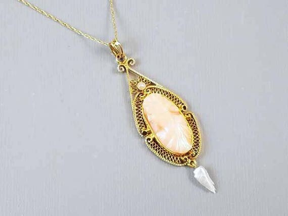 Antique Edwardian peach coral cameo 10k gold filigree lavalier pendant necklace with dog tooth pearl drop / Leys, Christie & Co Inc (NY, NY)