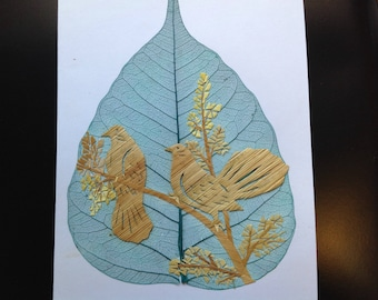 Birds on a leaf. Handmade with rice straw on a real leaf. Unique leaf art collectible at an affordable price. Have U seen ancient leaf art