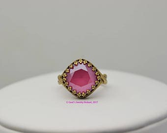 Swarovski Ring. Handcrafted Peony Pink Cushion Bead of 12mm set in Antiqued Brass Bezel Adjustable Setting.  Matching pieces available. OOAK