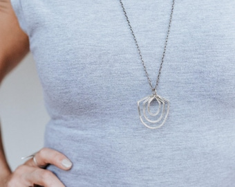 Geometric Sterling Silver Cycles Necklace