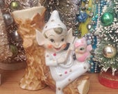 SALE Vintage Christmas bango playing gold polka dot elf pixie on tree branch with pink bird. Mantel decor. Holiday decoration. Ceramic.