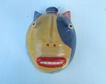 Calico cat w/ beetle clay wall sculpture