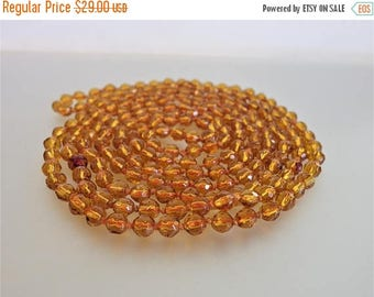 ON SALE Vintage Long 1920's Flapper Small Amber Glass Bead Necklace
