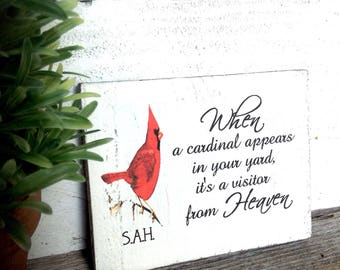 Personalized  When a Cardinal appears in your yard it's a visitor from heaven rustic wood sign -Size is 5 1/2 wide X 4 1/2 length 1 in thick
