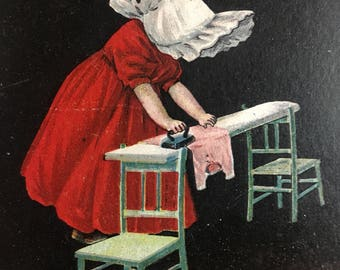 Dutch girl ironing image 8x10 reproduced on 8 1/2x11 heavy cardstock.