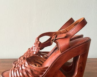 Truly amazing 1970s leather platform sandals with wood cut out heel