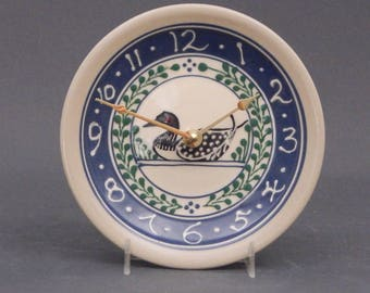 Small Stoneware Clock Loon design with Green Accents