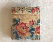 Needle-case in Vintage French fabrics, faded, worn with tiny, surprise pocket, red and pink roses, aged patina.