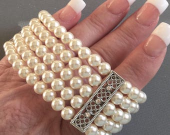 Pearl Bridal Bracelet with Silver bars and rhinestone is a 5 multi strands cuff of Swarovski Pearls in Cream ivory or your choice of col