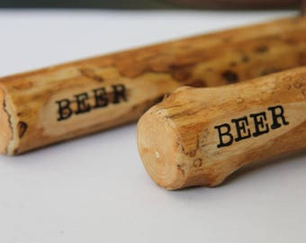 beer stick - bottle opener - made from maple with bark removed