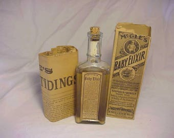 c1890s McGee's Baby Elixir for Teething Stomach and Bowels By The Mayfield Medicine Co. Mayfield, KY. Baby Medicine bottle with paper Label