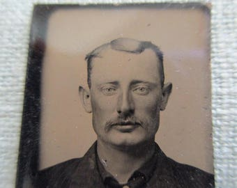 antique small tintype photo - 1800s, man with rugged face, flat head