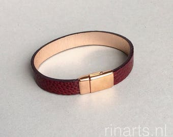 Leather bracelet made from burgundy red ostrich (leg) skin with rose gold closure. Luxury burgundy red bracelet