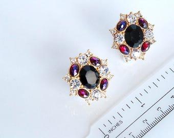 Vintage Monet  Earrings  with Purple  rhinestones #