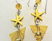 Yellow asymmetrical drop frosted glass ear rings with star fish focal beads wire wrapped sterling silver 44.00