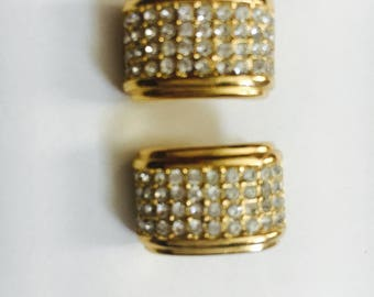 Christian Dior gold tone clip on earrings with rhinestones