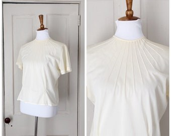 The Sunrise 1950s Short Sleeve Cream Blouse with Sun Ray Like Pleat Details